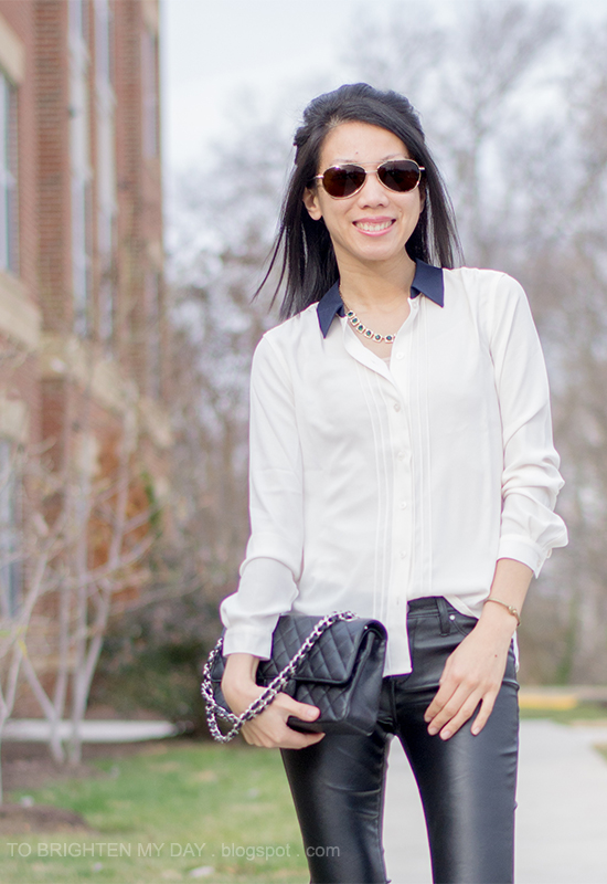 white blouse, emerald necklace, faux leather pants