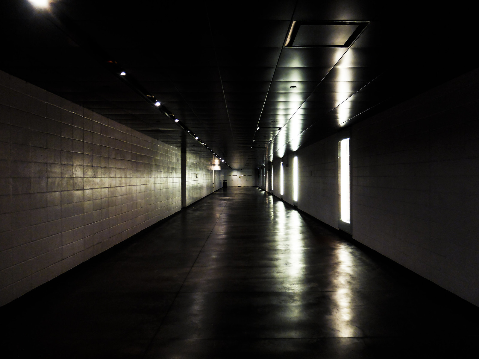 A stark corridor under Lincoln Center, warm and isolated from the cold wind. by wwward0