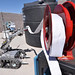A hazardous devices team robot pulls a fire hose from a reel during a Robot Rodeo competition and exercise.