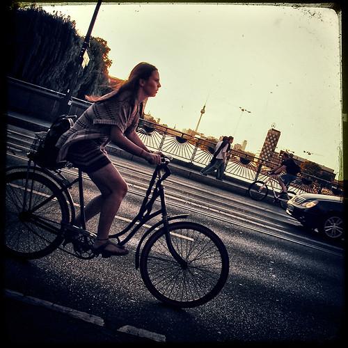 girl on bike by andrè t.