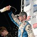 Simon Pagenaud showers himself in champagne during post-race festivities for the 2013 Grand Prix of Baltimore