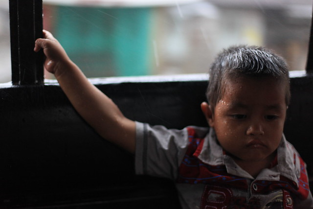 Child on bus in rain, Kutacane, Sumatra
