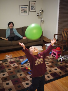 Happy boy playing with a balloon