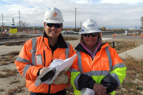 Photo of Adolfo Nietch and Christine Reed, safety officer and flagger respectively, near Havana Street and Smith Road