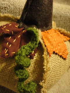 Burlap pumpkin with embroidered leaves