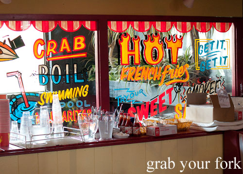 Crab boil and swimming pool margarita signage at House of Crabs, Norfolk Hotel, Redfern