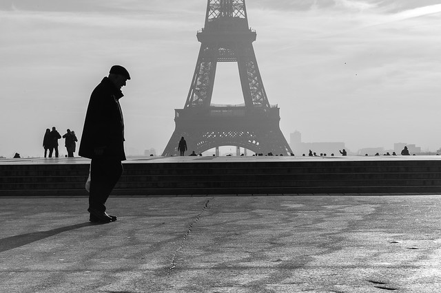 Old man thinking in front of the Eiffel Tower, Paris