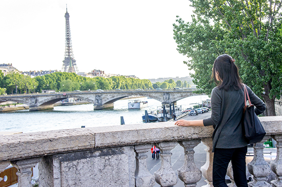 at Pont Alexandre III bridge overlooking the Eiffel Tower
