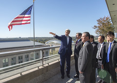 From the balcony of the eighth floor of the U.S. Department of State, U.S. Secretary of State John Kerry points out Washington, D.C., and Arlington, Virginia, landmarks and buildings to Vietnamese Executive Secretary Dinh The Huynh before their working luncheon on October 25, 2016. [State Department photo/ Public Domain]