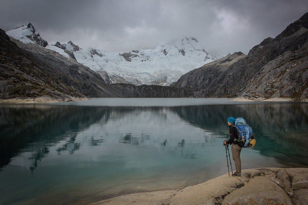 Laguna Cullicocha reflects the complete Santa Cruz (6241m) massif. Huascaran National Park. Cordillera Blanca. Peru.