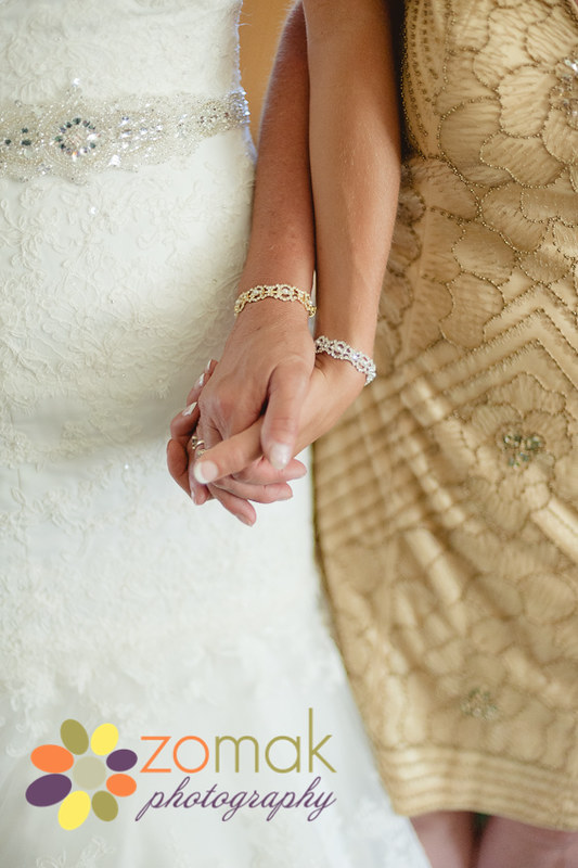 mother and daughter wear matching bracelets on Melissa's wedding day
