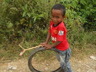 playing with a tire and stick