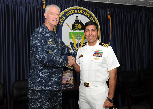 San Diego - Commodore, Destroyer Squadron One, Capt. Michael Elliott (left), presents a coin to USS Gridley Commanding Officer, Cmdr. Gadala Kratzer on behalf of Director, Naval Center for Combat and Operational Stress Control.