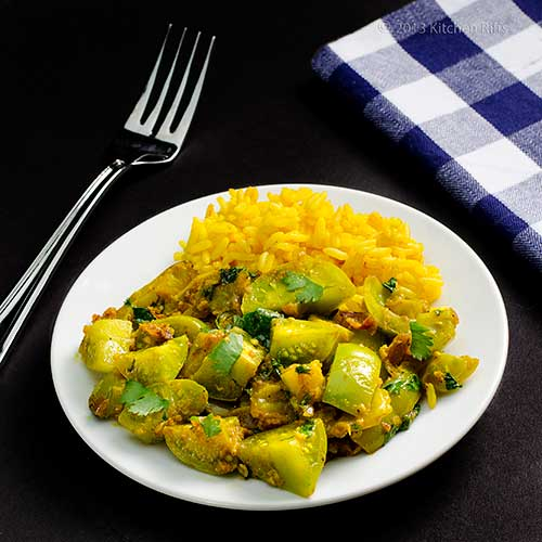 Curried Green Tomatoes on plate with spicy rice