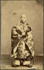A person in a ceremonial dress, Japan.