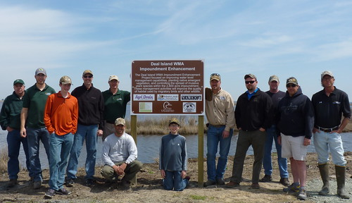 Crews posing in front of the newly restored pond