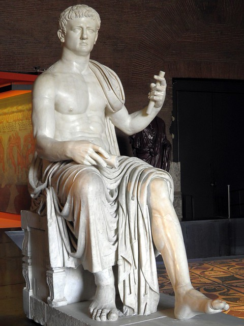 Colossal statue of Claudius seated and depicted in the act of speaking, from the Augusteum, so called Basilica of Herculaneum