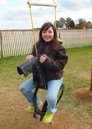 Julia on the tire horse swing