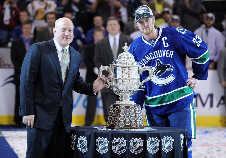 Captain Henrick Sedin is presented the Clarence S. Campbell Bowl.
