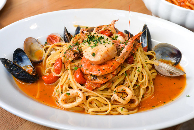 Tagliolini in Canna a Mare tagliolini with fresh clams, fresh mussels, calamari, scallops and tiger shrimp in a light tomato sauce