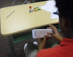 How can we determine the surface area of a box? This student covered the box with grid paper and counted the square units. (March 2012, Gr 5)