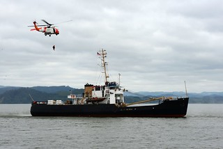 A Coast Guard member from the vessel boarding security team located at Coast Guard Sector Columbia River is lowered from an Air Station Astoria MH-60 Jayhawk helicopter to the motor vessel Ironwood, a Tongue Point Job Corps Center training ship, during a maritime response exercise held in Astoria, Ore., May 21, 2014.  The Coast Guard members were deployed to the Ironwood where they inspected the vessel for potential security concerns.  U.S. Coast Guard photo by Petty Officer 1st Class David Mosley