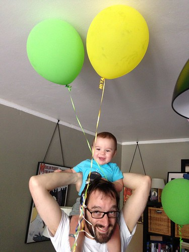 Elliott on Daddy's Head Playing with Balloons