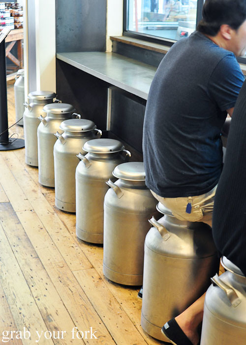 milk pail seating at beecher's handmade cheese flatiron district nyc new york usa