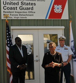 Congresswoman Donna Christensen addresses members of the press and invited guests during the inauguration of Coast Guard Resident Inspection Office and Boat Forces facilities Jan. 24, 2014 in Christiansted, St. Croix, U.S. Virgin Islands.  To the far right is Raymond Williams, U.S. Virgin Island Lieutenant General's Office Chief of Staff, and to the far right is Capt. Drew W. Pearson, Commander, U.S. Coast Guard Sector San Juan