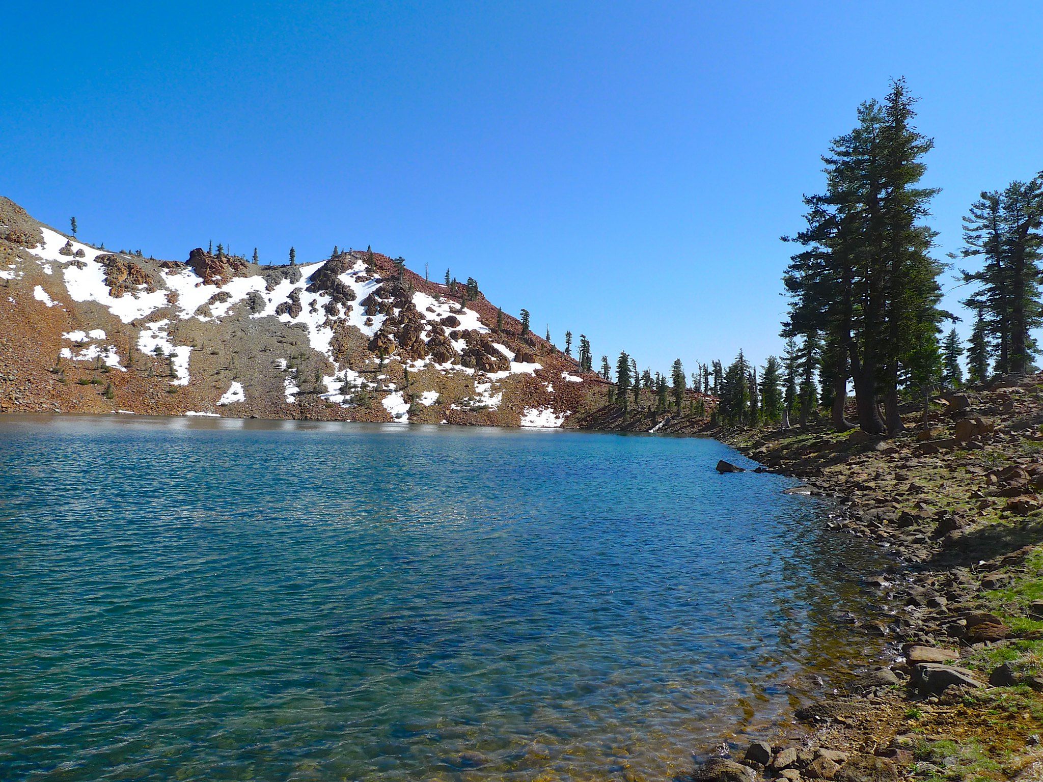 Summit Lake has beautiful clear azure water. Would be great for swimming later in the summer!