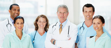Group of doctors smiling against blur background