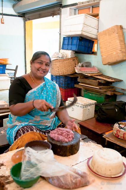 fisherwoman mincing her wares