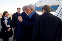 U.S. Secretary of State John Kerry is greeted by U.S. Ambassador to Germany John Emerson after deplaning at Berlin International Tegel Nord Airport in Berlin, Germany, on December 5, 2016, before a bilateral meeting with German Foreign Minister Frank-Walter Steinmeier and receiving the Order of Merit from the German government. [State Department photo/ Public Domain]
