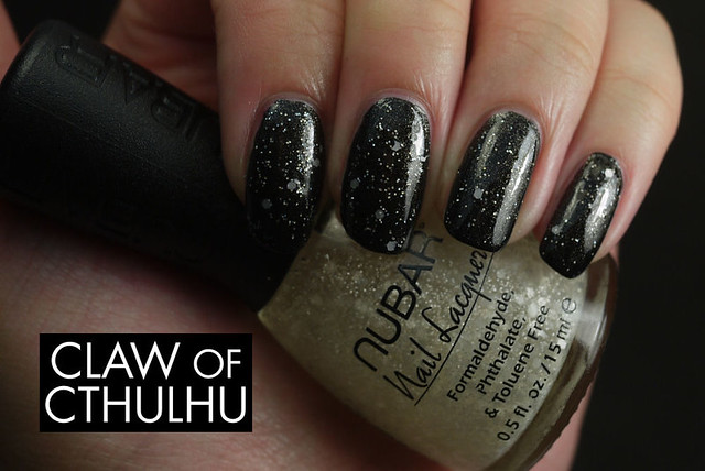 Fancy Nail Lacquer by Rainbow Honey Fancy Black Swatch (with Nubar White Polka Dots)