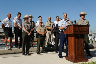 Lt. Michael Cortese, commanding officer of Coast Guard Station Miami Beach, Fla., along with representatives from the National Park Service, Florida Fish and Wildlife Conservation Commission, and local authorities hold a Columbus Day weekend media briefing Thursday at Base Miami Beach to stress boating safety during the busy holiday weekend (Oct. 11-14). In light of the numerous boating accidents and fatalities that have occurred in South Florida during past holiday weekends, and to ensure the safety of the boating public, a unified command of federal, state and local agencies will be patrolling the waters and conducting safety and boating-under-the-influence checks during the Columbus Day weekend. (U.S. Coast Guard photo by Petty Officer 3rd Class Jon-Paul Rios)