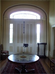 The front hall of Clarendon House at Nile in Tasmania with beautiful Georgian style double doors.