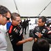 Juan Pablo Montoya chats with Team Penske crew members at Sebring