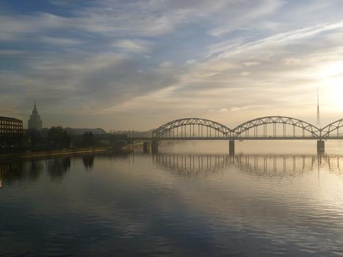 bridge church river latvia hazy riga daugava
