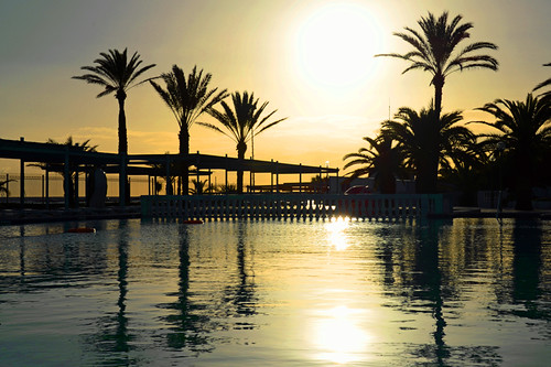 vacation holiday reflection tourism water pool yellow sunrise reflections palms hotel nikon tunisia d800 trabel portelkantaoi