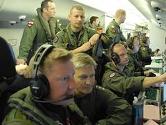 Vice Adm. Robert L. Thomas observes operations aboard a P-8A Poseidon. (U.S. Navy photo)