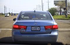 wheel(0.0), automobile(1.0), automotive exterior(1.0), hyundai(1.0), vehicle(1.0), hyundai sonata(1.0), mid-size car(1.0), sedan(1.0), land vehicle(1.0), vehicle registration plate(1.0),