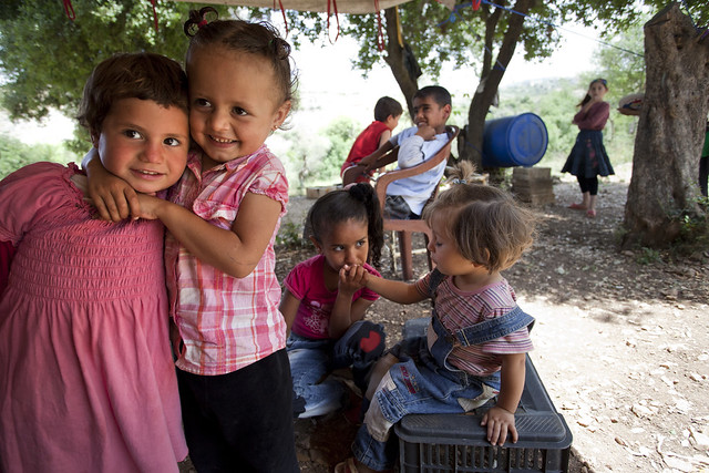 Syrian refugee children play with one another in the Ketermaya refugee camp
