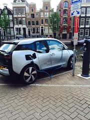Electric car fueling up in Amsterdam, Netherlands