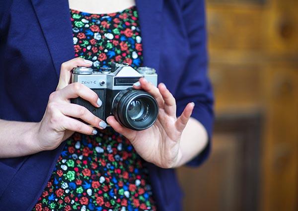 Zenit E Film Camera  against Floral Print Dress