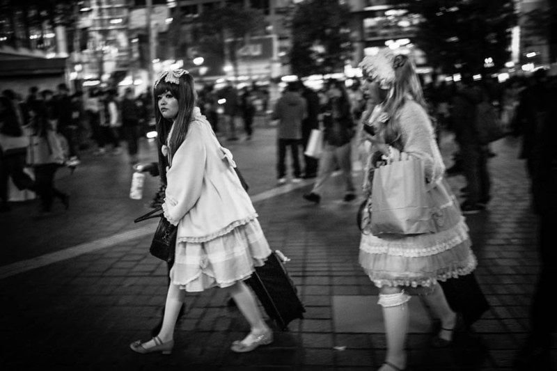 Dressed up girls at Shibuya Crossing at night