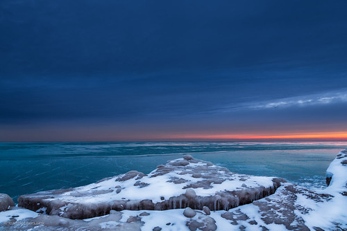 winter sunset sun lake chicago cold ice clouds sunrise season frozen illinois twilight rocks unitedstates jetty cliffs lakemichigan il evanston hanusiak polarvortex