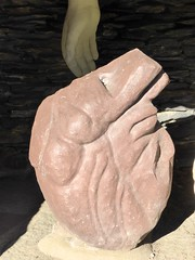 human body(0.0), organ(0.0), statue(0.0), hand(1.0), carving(1.0), art(1.0), clay(1.0), sculpture(1.0), stone carving(1.0), rock(1.0),