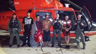 Coast Guard rescues 2 men, 1 child from sinking boat