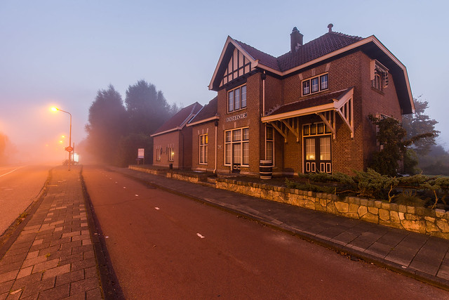 An old train station called 'Oosteinde' (1915-1972) at daybreak in the morning fog.