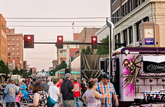 """Fans inspect """"Wicked,"""" a 2015 Peterbilt 379, at the Shell Rotella SuperRigs parade in downtown Joplin Missouri"""